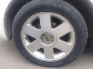 Ford laser trắng 2003 số sàn