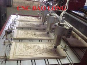Máy cnc 4 đầu đục tranh gỗ, chạm nội thất đồ gỗ.