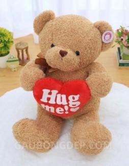 Gấu Teddy lông chỉ ôm tim Hug Me đeo nơ màu cà phê sữa