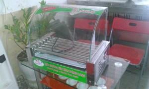 Máy nướng xúc xích kính xong 7 thanh,máy nướng lạp xưởng xoay tròn,máy gián xúc xích dùng điện