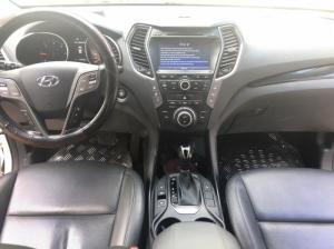 Bán Hyundai Santafe 4WD máy dầu 2015 màu trắng biển SG full options