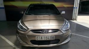 Bán Hyundai Accent blue 1.4AT nhập 2014 5 cửa màu nâu số tự động
