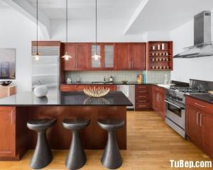 Tủ bếp gỗ Laminate thiết kế chữ L màu vân gỗ hiện đại – TBT51