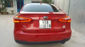 Bán Kia K3 2.0AT màu đỏ tươi xinh sản xuất 2014 biển Sài Gòn bản cao cấp full options