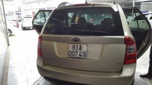 Bán Kia Carens SX 2.0AT màu vàng cát số tự động sản xuất  cuối 2010  7 chỗ
