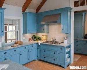 Tủ bếp gỗ Xoan Đào màu xanh ấn tượng chữ L – TB83