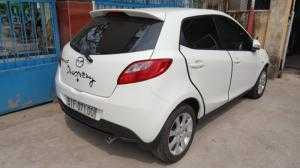 Bán Mazda 2 S 1.5AT màu trắng số tự động bản 5 cửa sản xuất 2015 biển Sài Gòn