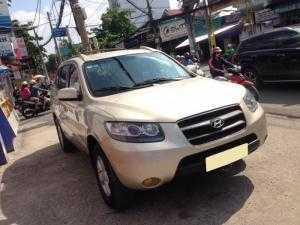 Cần bán xe Hyundai SantaFe 2009 máy dầu số sàn vàng gold