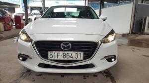 Bán Mazda 3 FaceLift 1.5AT màu trắng số tự động bản sedan sản xuất 2017 biển Sài Gòn lăn bánh 40.000 km