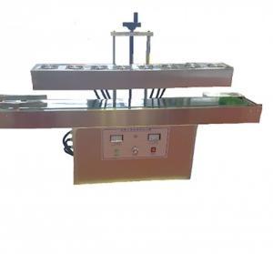 Máy dán màng seal hủ hạt điều tự động, máy dán seal màng nhôm chai dầu nhớt tự động LX 6000