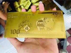 Tiền con heo macao mạ vàng plastic