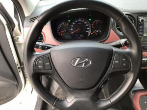 Bán Hyundai Grand i10 1.2AT sedan màu trắng số tự động sản xuất 2018 bản cao cấp
