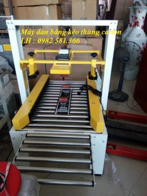 Máy dán băng dính thùng carton, máy dán băng dính thùng FXJ 6050