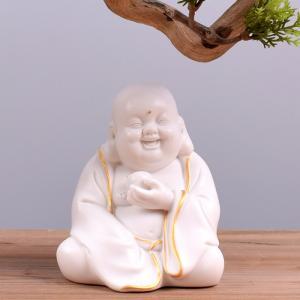 Tượng Tiếu Phật gốm trắng