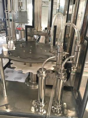 Máy cấp nắp siết nắp chai nước tinh khiết tự động tphcm