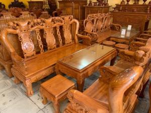 Bộ bàn ghế chạm đào đẹp mặt liền tấm tay 10 giá rẻ