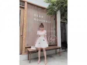Đầm váy nữ trắng xòe đính nơ đen