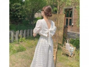 Đầm váy nữ trắng xòe tay phồng nơ lưng