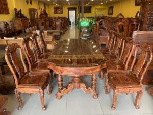 Bộ bàn ăn gỗ xịn sơn ta 8 ghế bàn ovan khuyết