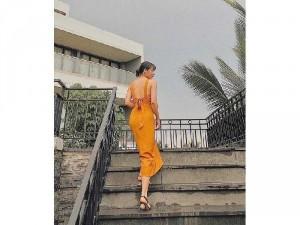 Đầm váy nữ maxi vàng 2 dây nơ lưng hở
