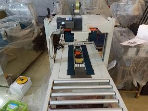 Máy dán băng dính thùng carton, máy dán thùng mặt trên mặt dưới bán tự động FXA6050