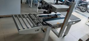 Máy dán băng keo thùng carton mặt trên và mặt dưới bán tự động FXA6050