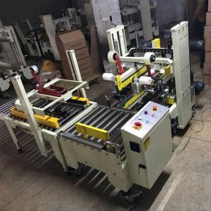 Máy dán băng dính thùng carton, máy dán băng keo 2 mặt trên dưới