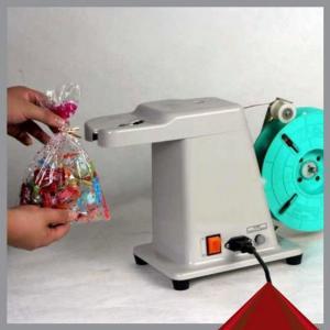 Máy buộc túi tự động, máy buộc bánh mì, giỏ quà..